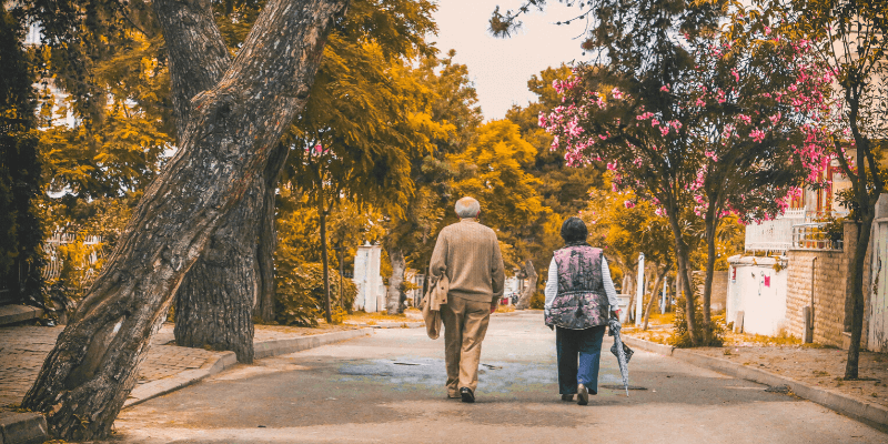 wound care and senior couple on a walk down the street